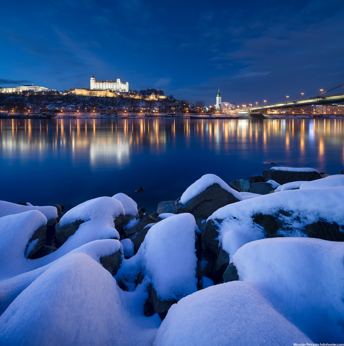 Snow covered rocks at the Danube
