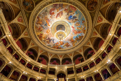 Opera ceiling Somehow recently I take more photos of ceiling. It's interesting to see that a lot of people newer look up and so miss some of the most beautiful elements in a room. This one is in the Opera house in Budapest. Really a beautiful example :)