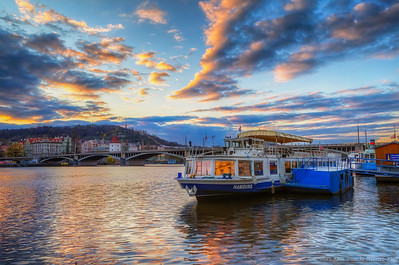 Vltava Sunset That was one cold evening when I took this photo. It was in April, but it was actually snowing few hours earlier. So it was cold and windy. But around sunset it got much better, so I was able to take some nice photos :)