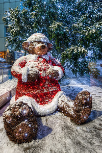 Christmas Bear  Not a photo from this winter, as I wanted at least on Christmas to post a photo with snow. This is a part of the decorations at the River Park in Bratislava, in front of the Kempinski hotel.  HDR from three shots, taken with Canon 450D with Sigma 10-20mm lens, from a tripod.