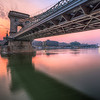 <h2> Budapest sunrise </h2>  I almost lost my lens hood when I was shooting that morning. I still was a little sleepy (I got up at 3:50 after a 4 hour sleep) and I haven't noticed that the lens hood is not correctly attached. And as I moved to a new spot, it fell of and started rolling towards the Danube. I actually caught it after it went over the edge, which was almost quite stupid of me, as I few centimeters more I would be over the edge too. One really has to be careful :)