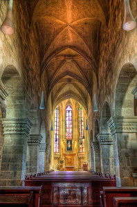 Inside the Parish Church in Bad Deutsch-Altenburg  You could say, that this was the only composition I could do in this church. The reasons was a gate, preventing me from entering the church :) So I put the tripod as close to the gate as possible, so the lens is on the other side, an took few shots.  HDR from three shots, taken with Canon 450D with Sigma 18-200mm lens, from a tripod.
