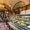 <h2>A sweet place</h2> Cafe Gebreaud in Budapest is a great place for everyone who likes cakes and coffee. And together with the great atmosphere there it's no wonder than it is quite popular. No people in this photo, as it was taken few minutes before they open :)