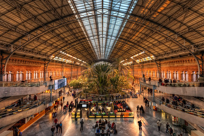 Train Station or Garden  Or both :) This is how a train station should look like :) When you are waiting, you take a walk in the garden. This is the Interior plaza in the old Atocha station in Madrid. Really a stunning place. I took this shot only handheld, but I placed the camera on the railing and held it down. It worked quite well :)  Get more info about this photo on my blog http://blog.hdrshooter.net