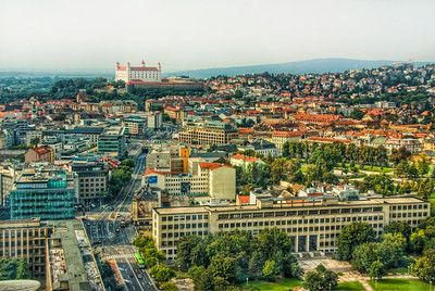 Little bit of Bratislava  A little different than the classic view of the Bratislava Castle. To bad, the sky was not that great that day, thats why there is only so little of it in the photo :). Also i had to remove a lot of reflection from the sky, as this photo was taken through double glass windows. Photo taken from the 30 floor of the Slovak National Bank.  HDR from three shots, take with Canon 450D with Sigma 18-200mm lens, handheld.