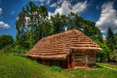 Straw roof  How about a nice shot, taken last summer :). This is one of the old houses in the open air museum in Bardejovske Kupele in eastern Slovakia. It was such a lovely day, with all those beautiful white clouds, excellent for HDR :).  HDR from three shots, taken with Canon 450D with sigma 10-20mm lens, from a tripod