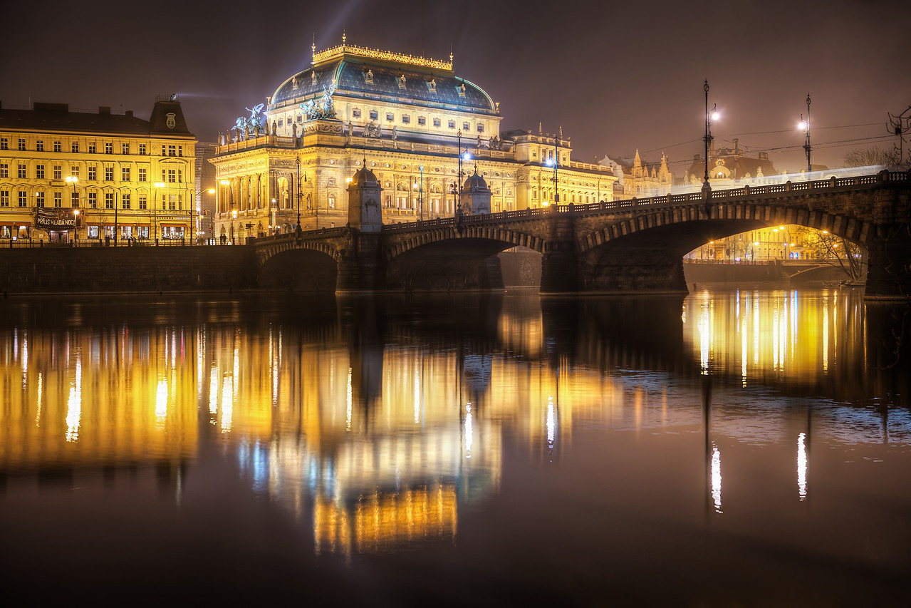 A fogy reflection A bridge and a reflection. Two most common elements in my photos. This time it's of the National Theatre Opera in Prague and the Bridge of Legions.