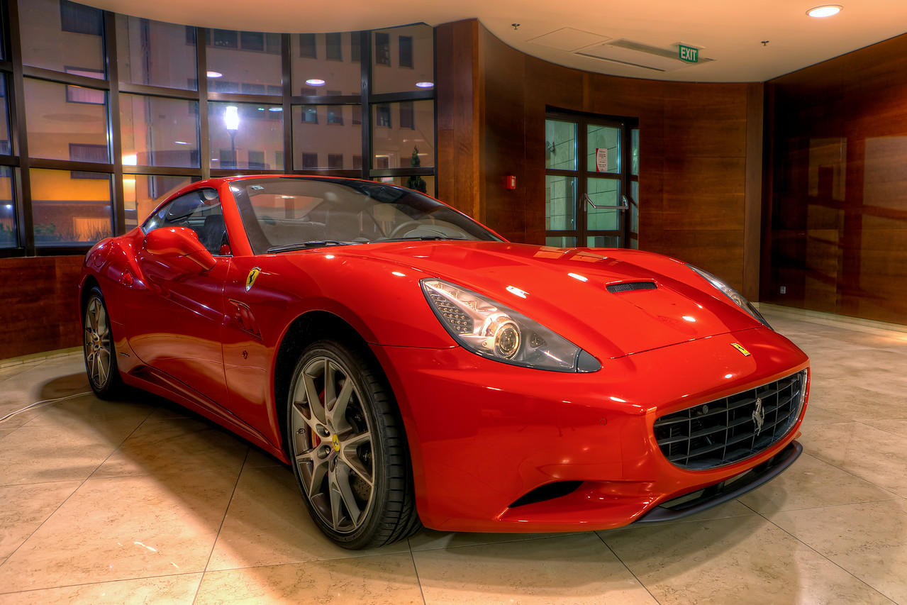 The Red Ferrari 599  Could be very interesting to ride one of these. But who would let me do it, probably no one. But at least I can take photos. I had to play with the red in this one quite a lot. As it was inside a building, the interior lights gave it quite a yellow color. But with a lot of masking and hue/saturations adjustments, I think it looks as it should. I took 5 brackets for this HDR, as it was quite enough. If you look at the before/after you will see, that there was not that much of a dynamic range in the scene.