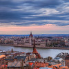 <h2>Cloudy sunset in Budapest</h2> Not the most colorful of sunsets. The cloudy sky made the photos look really grey.