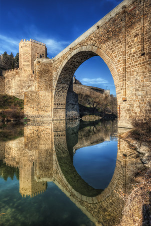 The big 10  or one of the old bridges in Toledo (I couldn't find how it's called). I of course couldn't resist not to go under the bridge to take few shots. The water was really calm that day, giving me this perfect reflection :)  Get more info about this photo on my blog http://blog.hdrshooter.net