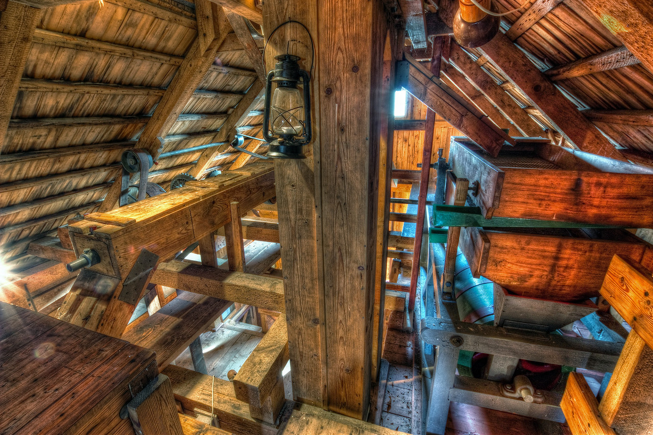 Lamp  Another photo, taken inside the water mill in Jelka. The combination of wood and metal give it a really nice detailed look.    HDR from three shots, taken with Canon 450D with Sigma 10-20mm lens, from a tripod