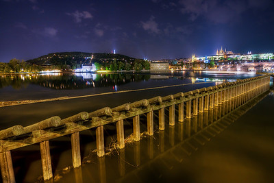 Night in Prague  Another night shot for today :) I could spend hours and days taking night pictures of Prague, and I hope I will :) What I really love about this scene, is that everything has a reflection here, every single part :)  HDR from three shots, taken with Canon 450D with Sigma 10-20mm lens, from a tripod.