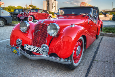Red  These old cars are so beautiful, and great for HDR :)  HDR from three shots, taken with Canon 450D with Sigma 10-20mm lens, from a tripod.