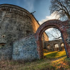Red Stone Gate<br /> <br /> This is a gate in the fortifications of the Cerveny Kamen (Red Stone) castle in Slovakia. As there was a very hight wind when I took this shot, I had to repair most of the sky, because the trees just would line up :)<br /> <br /> HDR from 6 shots, taken with Canon 450D with Sigma 10-20mm lens, from a tripod.