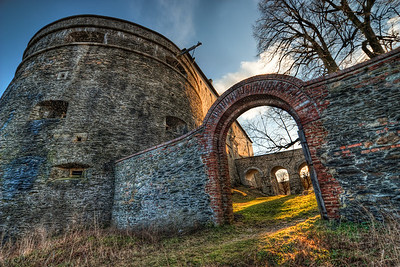 Red Stone Gate  This is a gate in the fortifications of the Cerveny Kamen (Red Stone) castle in Slovakia. As there was a very hight wind when I took this shot, I had to repair most of the sky, because the trees just would line up :)  HDR from 6 shots, taken with Canon 450D with Sigma 10-20mm lens, from a tripod.
