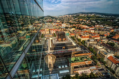 Double City  Quite a busy day today. Got to visit the National Bank of Slovakia building in Bratislava as they had an Open Day. As it is the highest building in Bratislava (and whole Slovakia) i had to use the chance to take few photos.  In this shot is the Slovak Radio building and its surrounding areas. Taken from the 30th floor. Too bad I only could take the pictures through double glass windows.  HDR from three shots, taken with Canon 450d with sigma 10-20mm lens, handheld.