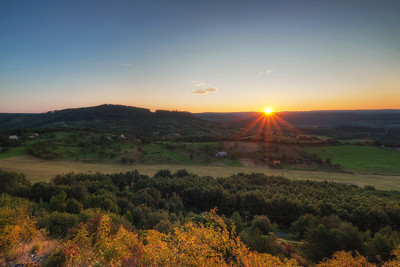 Beautiful Sunrise  I had to wake up at 4:45 so I can catch the sun, as it got up from behind the hills. Bu I think it was worth it. In the photo the Stary Haj area in central Slovakia.  HDR from three shots, taken with Canon 450 with Sigma 10-20mm lens, from a tripod.