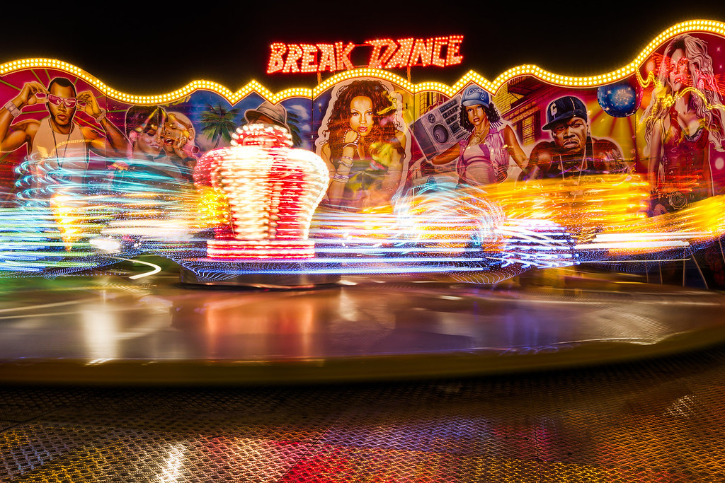 Break DanceI tried a lot of different setting here, mostly trying out shorter and longer exposures. At the end I  had this :). I just love the colors and motion which was captured.HDR from three shots, taken with Canon 7D with Sigma 10-20mm lens, from a tripod.