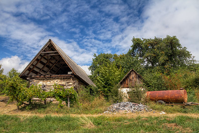 The big and the small  A little more random photo. I just like how this old (abandoned) house was standing next to this mall hut, so I took it :)  HDR from three shots, taken with Canon 7D with Sigma 10-20mm lens, from a tripod.