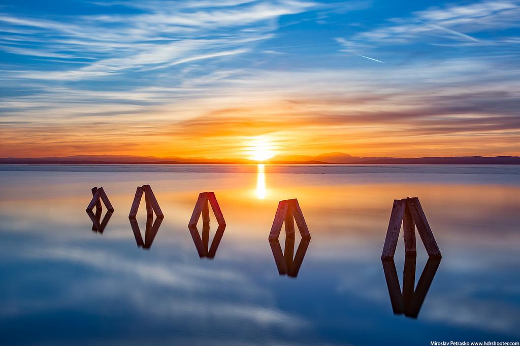 Calm sunset reflection at the Neusidler See, Austria, Podersdorf