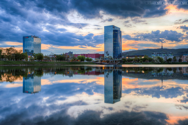Sunset reflection Again an older photo, taken earlier this year. As soon as the weather gets better in Bratislava (and the sky won't be just grey), I plan to revisit Kuchajda lake for some nice Panorama shots :) I know, that as long as there won't be much wind, the reflection will be perfect :)