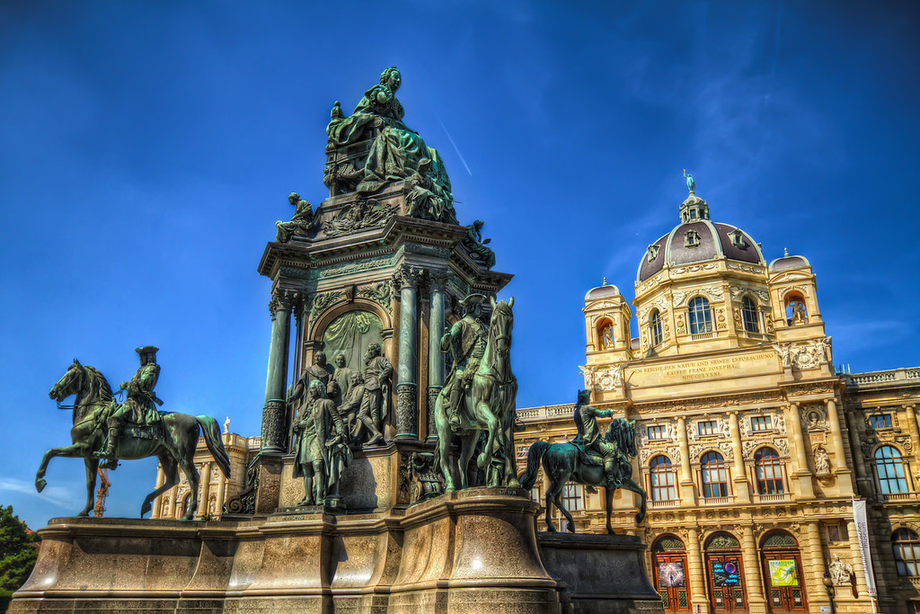 Statue on the Maria-Theresien-PlatzOne from Vienna today. These old statues look so great in hdr. All the detail just shows in the photo. This was taken on a very hot, very sunny day, which is quite visible on the photo. The sky was really this blue :)HDR from three shots, taken with Canon 7D with Sigma 10-20mm lens, handheld