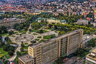Looking down  Another one from yesterday. I'm quite happy with this one, as there are no visible reflections from the windows I took this shot through and it came out nice and sharp. I edited it so, there is as much detail as possible.  In this shots you can see the Freedom Square, Ministry of transportation and the Cabinet office of Slovak Republic  HDR from three shots, taken with Canon 450D with Sigma 18-200mm lens, handheld. Photo taken from the 30th floor of the National Bank of Slovakia building.