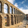 """Aqueduct of Segovia<br /> <br /> I had no luck for a nice light in Segovia. The day was quite cold and cloudy. Only later the sky cleared a little, but still, the light was horrible. But I tried my best. I actually edited this photo 2 times, as I was so dissatisfied with the first result, that I deleted it and started once more :)<br /> <br /> Get more info about this photo on my blog <a href=""""http://blog.hdrshooter.net"""">http://blog.hdrshooter.net</a>"""