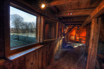 Looking Outside  This was a hard one. I took 9 exposures, everything from -4 to 3 (I took the 0 twice because of AEB) and it still wasn't enough to capture the clouds outside. But I think it came out still quite nicely :)  This photo was taken in the Water Mill in Jelka. HDR from 8 shots, taken with Canon 450D with Sigma 10-20mm lens, from a tripod.