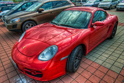 Red Porsche  How about a nice shiny car? :) I really liked how the surroundings reflected on the car, so I took this shot :)  HDR from three shots, taken with Canon 450D with Sigma 10-20mm lens, handheld.