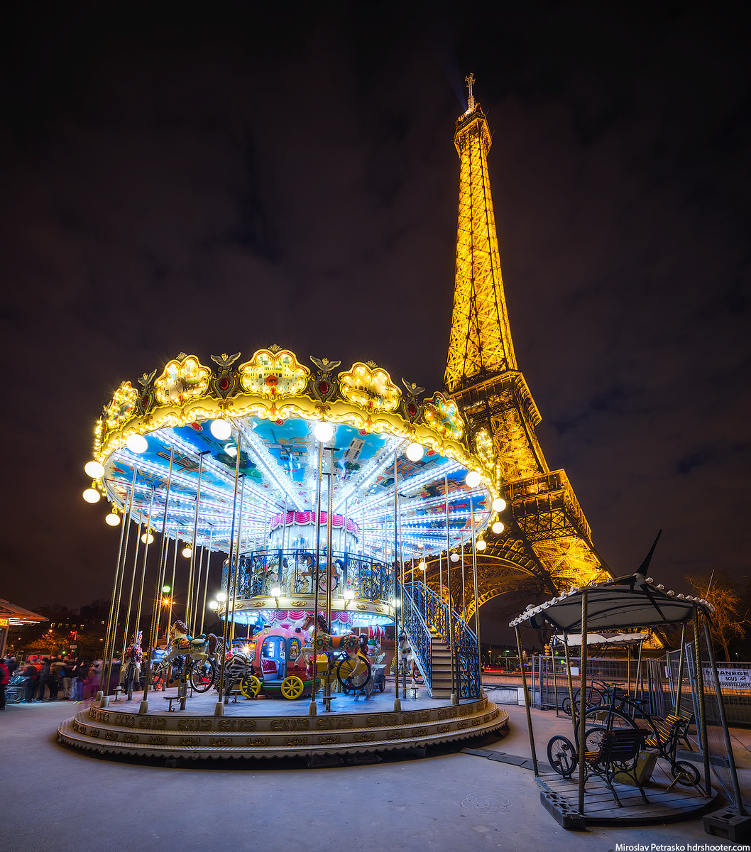 Carousel under the Eiffel tower, Paris, France