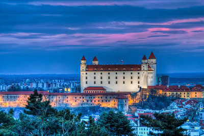 Different angle  I think I haven't uploaded a photo of the Bratislava castle from this angle yet :). I took this from the Slavin memorial during quite a windy day. There was a nice sky around sunset, so I zoomed in quite a lot and did my best to hold the tripod steady :) The perspective is a little flatter on this one. It's a little strange for me, as I usually shoot with a wide-angle lens. But it's always nice to try something else :)  HDR from three shots, taken with Canon 450D with Sigma 18-200mm lens, from a tripod.