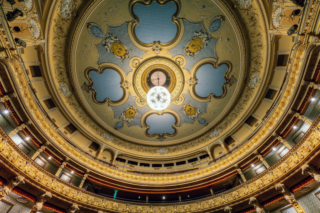 Decorated ceiling A lot of people from Bratislava will not recognize where was this taken. I wouldn't either a few weeks ago. But now I know, that this is the ceiling in the historical building of the Slovak National Theater. The light in the middle is also very interesting. It's created from hundreds of old style light bulbs and can be switched into different configurations, of which ones are turned on.more info on this photo can be found on my blog https://www.hdrshooter.com