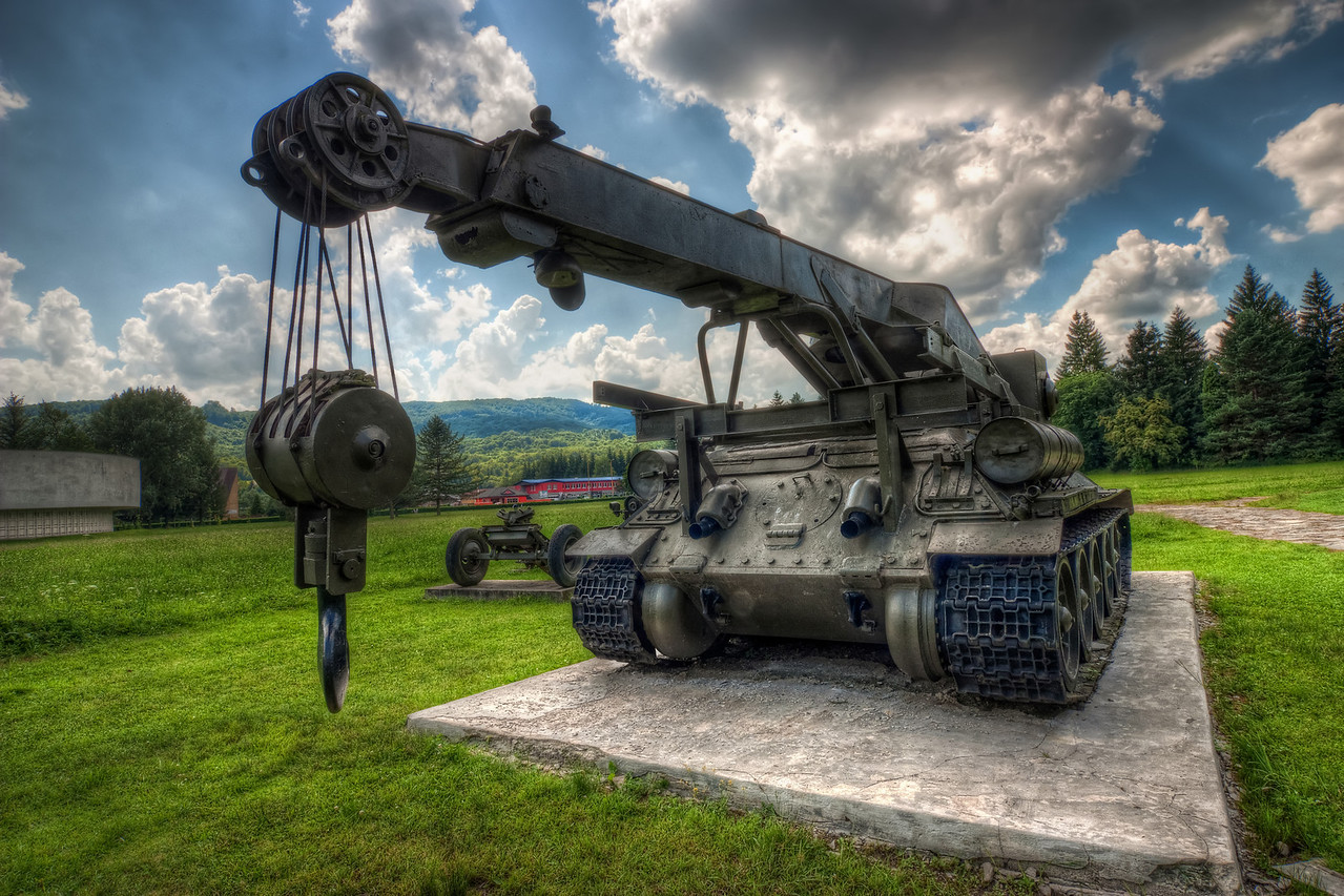 Military Vehicle  I was a little busy yesterday (seems to happen to me quite a lot the last month) so I instead of creating a new HDR, I selected one of my very old ones. I edited this probably more than 6 months ago :).   This one was taken at the military museum in Svidnik, when I was there in 2010.  HDR from three shots, taken with Canon 450D with Sigma 10-20mm lens, from a tripod.
