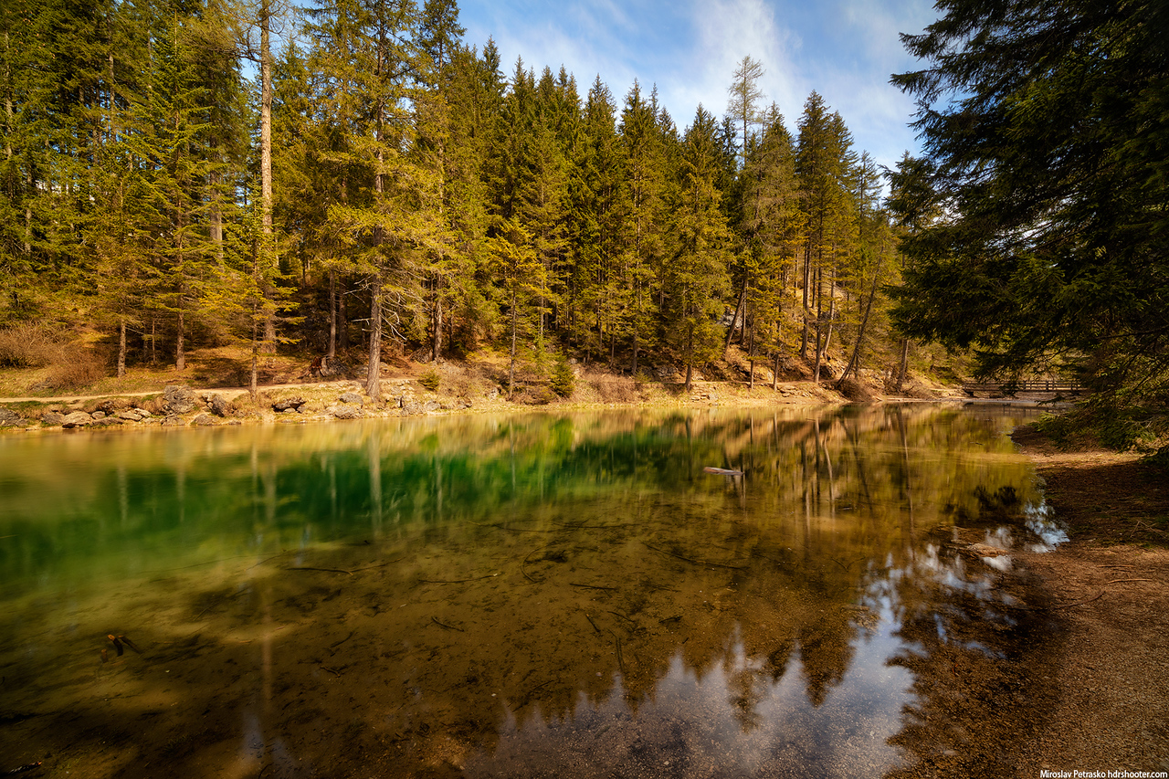 Sunny day reflection at Lago di Braies