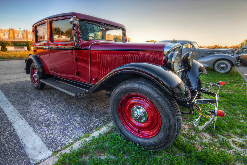 Red Beauty  I really like taking photos of this beautiful old cars, but usually you only see them in museums, where is a horrible lighting. So I really taken a lot of photos, when I had them out in the city :) (so there will be more :))  HDR from three shots, taken with Canon 450D with Sigma 10-20mm lens, from a tripod.