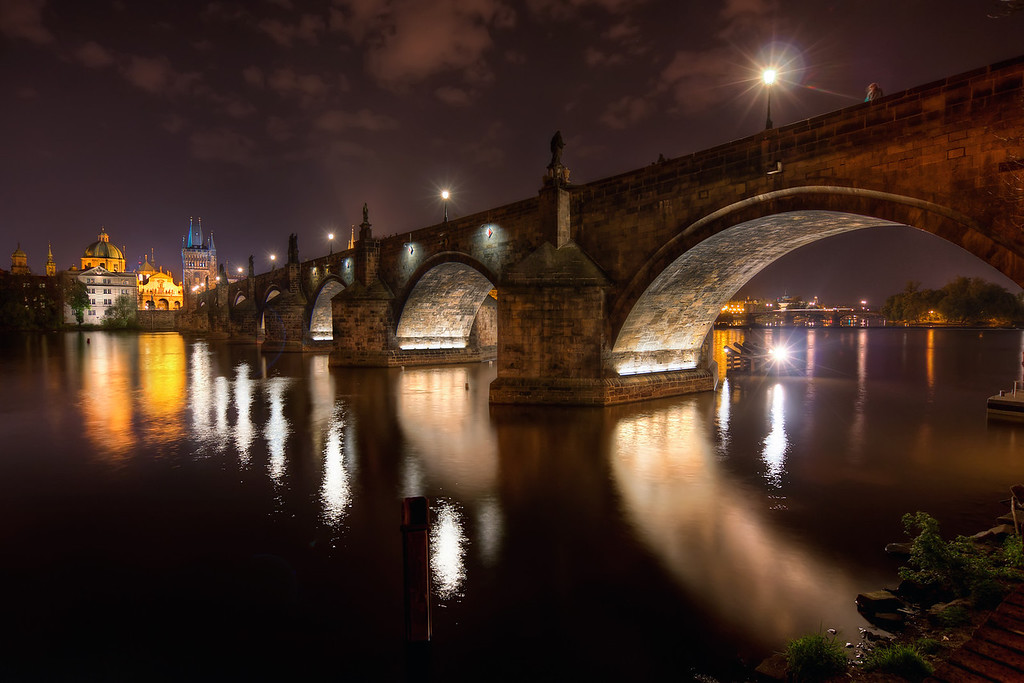Karl's Bridge at Midnight.  Back home after few days in Prague. Of course I took many photos and most of them bracketed for HDR :). So this week most (or all :)) photos will be from Prague. Let's start with something really well know, the Karl's Bridge. As I had no luck for clouds during the day, I was very happy that there were some at night. This photo was taken around midnight :)  In the past I had a lot of problems with my night shots. Usually the camera focused on everything, just not what I wanted, So these time (after years of having the camera) I used live view and manually focused all my night shots. I think the results are much better, than when I used auto-focus.  HDR from three shots, taken with Canon 450D with Sigma 10-20mm lens, from a tripod.