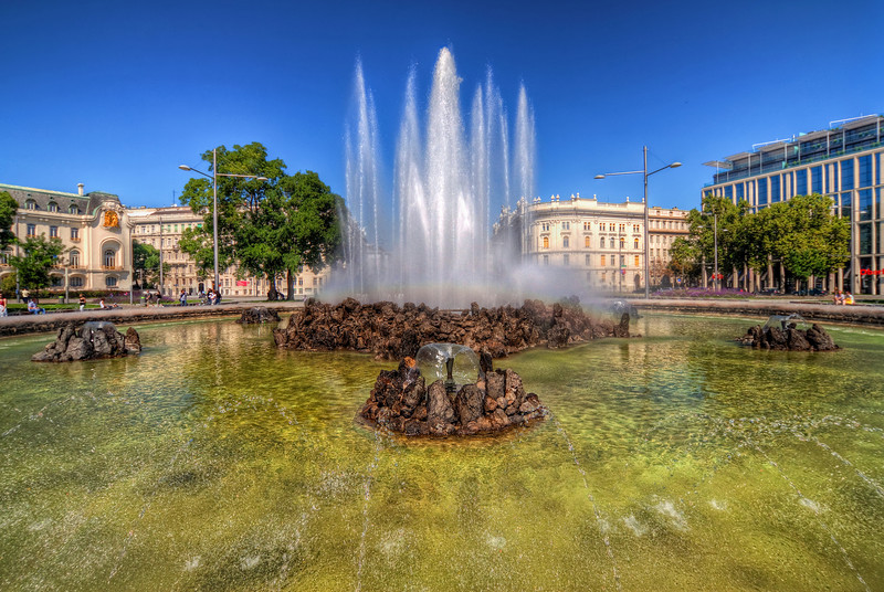 Fountain in Vienna  I took this shot during one very sunny day. I really like what color the fountain was, with all those water drops creating a very nice texture on the surface. The photo is a little more centered that I would like it to be, but I like the bottom part so much, that I couldn't cut if off.   HDR from three shots, taken with Canon 450D with Sigma 10-20mm lens, handheld.