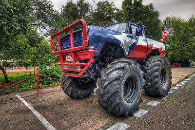 Monster truck  Not many possibilities to see monster trucks in Slovakia. So when there were some in Bratislava in the summer I went to take few photos. The weather was quite bad, with a ugly grey sky, so I includes only a little bit of it :)  HDR from three shots, taken with Canon 450D with Sigma 10-20mm lens, from a tripod.