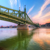 <h2>Not a very colorful sunset</h2> Comparing to my recent photos, this one is not so colorful. But as the sunset when I took it wasn't colorful at all, I had to add a lot of saturation. For those interested, this is the Liberty bridge in Budapest.