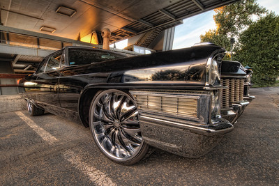 Black Cadillac  It's really rare to see a car like this in Bratislava. I was just so beautiful and shiny, I had to take few shots :). I saw it a few weeks before, and now when I was passing it again, I had my camera with me :)  HDR from three shots, taken with Canon 7D with Sigma 10-20mm lens, from a tripod.