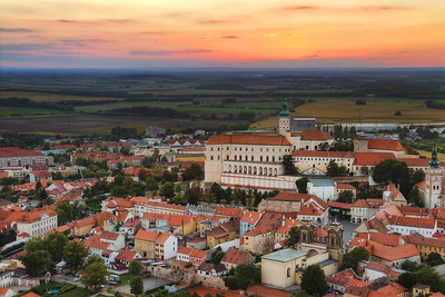 Sunset over Mikulov  The first time I was at Mikulov, I saw, that there is a very nicely situated hill right next to the city. So the second time, I went there, I went directly to this hill and waited for the sunset. And this is what I got :)  HDR from 7 shots, taken with Canon 7D with Sigma 18-200mm lens, from a tripod.