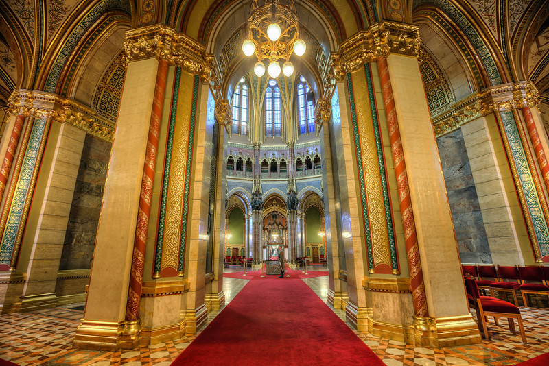 Hiding from the guards As each day, a new photo from me. Even today, when you are all busy voting for the contest winner :) This is another photo from the Hungarian Parliament. In the middle you can see one of the guards, and right behind him is the Hungarian crown. The guards there are real professionals. Even in a few second exposure, there was almost no movement from them :)