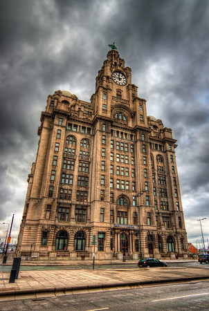 Royal Liver Building  This is my favorite building in Liverpool. It looks so majestic and I really like the style :). Had a little bad luck with the weather when I visited, but the grey sky gives the photo a little darker mood, which actually works quite nicely.  HDR from three shots, taken with Canon 450D with Sigma 10-20mm lens, handheld.