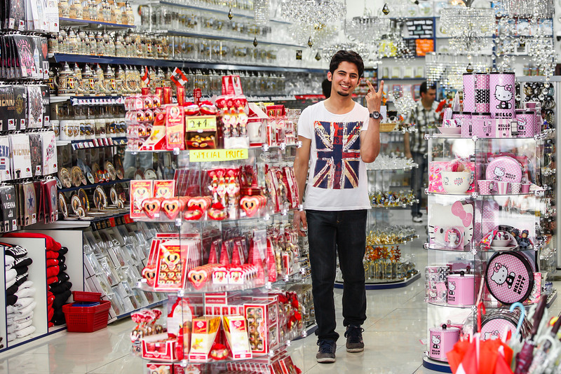 The souvenir kingdom You can find so many of these shops in every tourist location. I was actually taking more a photo of the shop, when this guy noticed me and posed a little. So I quickly refocused, making him the subject of the photo :)
