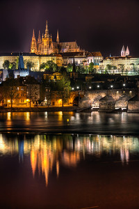 St. Vitus Cathedral reflection  Next one from Prague :). It was actually funny, looking at all the tourists around me, trying to take the same photo using a compact camera, usually also using flash :). I also think my best shots from Prague will be the night ones. The number of tourists then was already acceptable, so I could take my shots without being in a crowd.   HDR from three shots, taken with Canon 450D with Sigma 18-200mm lens, from a tripod.