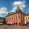 On the Main street<br /> <br /> A photo from Kosice (eastern Slovakia) for today. I spend 5 years there, studying at a university. You would think I know it quite well, but in the 6 years I'm no longer there, so much has changed that I could easily get lost :)<br /> <br /> I took this photo last summer when I was visiting friends there. The sky looks so lovely in this photo, with all those lovely white clouds, but it was just a deception. Not long after this, a really heavy storm came, so we had to hide in the orange building in the middle. But as it is a cake shop, I didn't mind at all :)<br /> <br /> HDR from three shots, taken with Canon 450D with Sigma 10-20mm lens, handheld.