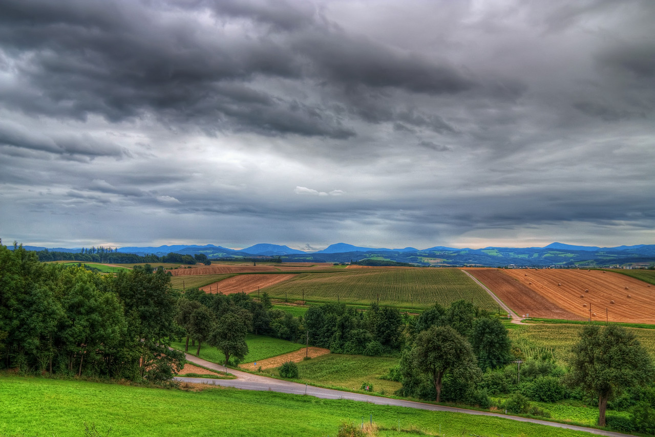 Somewhere in Austria  I have no idea where I took this shot :). It was taken on the way from Bratislava, Slovakia to Cologne, Germany and we were taking a break at a Gas station, from which was this lovely view. It was a very cloudy day, and it actually started raining in the next few minutes :)  HDR from three shots, taken with Canon 450D with Sigma 10-20mm lens, handheld.