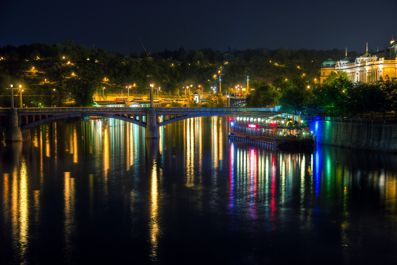 All the lights  I took this shot late at night from the Karl's bridge in Prague. I really like taking this kind of shots, having these long light reflections in the water. As for this photo, the ones taken from the camera were very warm, almost yellow, from all the lights. But with a lot of color correcting, it got this nice combination of yellow, green and blue.  HDR from three shota, taken with Canon 450D with Sigma 18-200mm lens, from a tripod. Again here I used manual focus, to be sure it focused correctly.