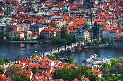 All the people on the Karl's Bridge  This is the view of the Karl's Bridge from the top of the Petrin tower. You should bring a nice zoom lens when you go there :). From this point you can really see how much people are on the bridge. It's really a lot :). This is one of those photos, where I would love to have a camera with more megapixels. There is so much detail lost in this photo.  HDR from three shots, taken with Canon 450D with Sigma 18-200mm lens, handheld.